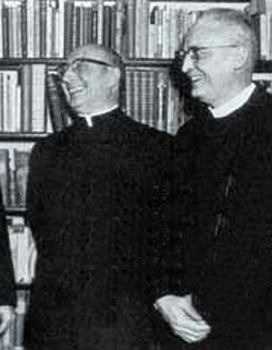 A black and white photograph of Fr. Diekmann laughing with members of the theological committee