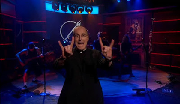 Fr James Martin making satanic symbols with a heavy metal band