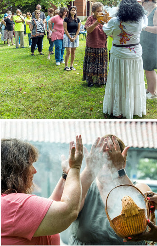 people line up to receive a native american incense blessing