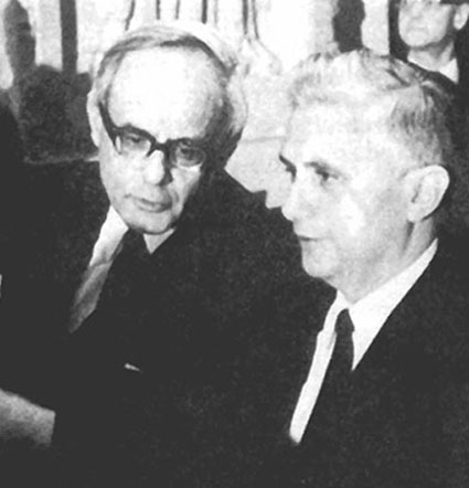 A black and white photograph of Fr. Ratzinger speaking with Karl Rahner