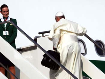 carrying suitcase Pope